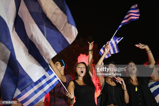 People celebrate in front of the Greek parliament as the people of Greece reject the debt bailout by creditors on July 6 2015 in Athens Greece The...