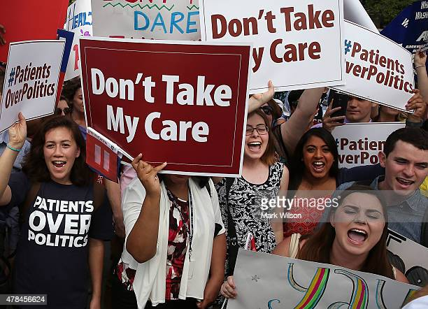 People celebrate in front of the US Supreme Court after ruling was announced on the Affordable Care Act June 25 2015 in Washington DC The high court...