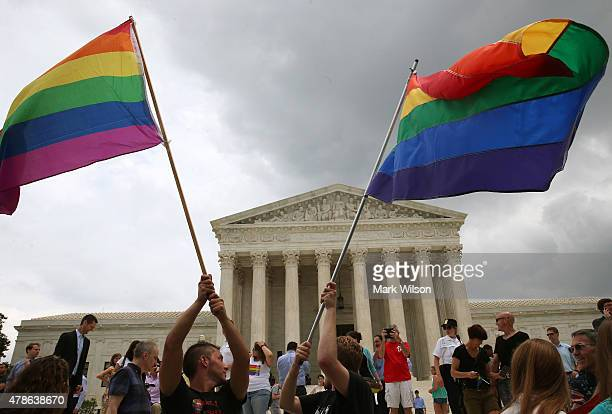 People celebrate in front of the US Supreme Court after the ruling in favor of samesex marriage June 26 2015 in Washington DC The high court ruled...