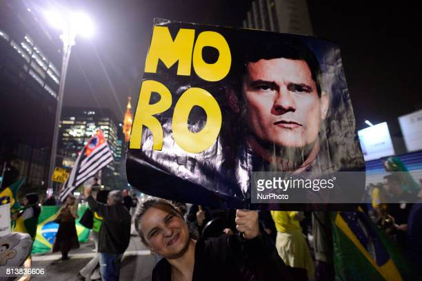 People celebrate in Sao Paulo Brazil July 12 after Brazil's former president Luiz Inacio Lula da Silva was sentenced to nearly 10 years in prison for...