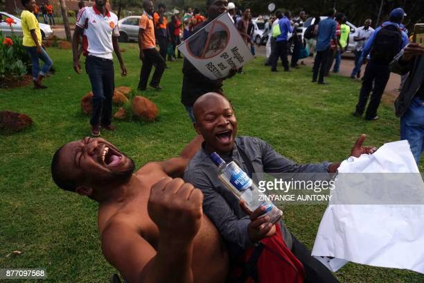 TOPSHOT People celebrate in the streets of Harare after the resignation of Zimbabwe's president Robert Mugabe on November 21 2017 The bombshell...