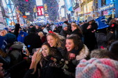 People celebrate in Times Square during the New Year's celebration on January 1 2013 in New York City An estimated one million revelers from around...