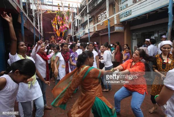 People celebrate on Ganpati immersion day in Mumbai