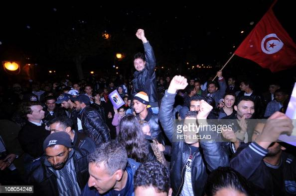 People celebrate on Mohamed V avenue in Tunis after Tunisian President Zine El Abidine Ben Ali's address to the nation on January 13 2011 Ben Ali...