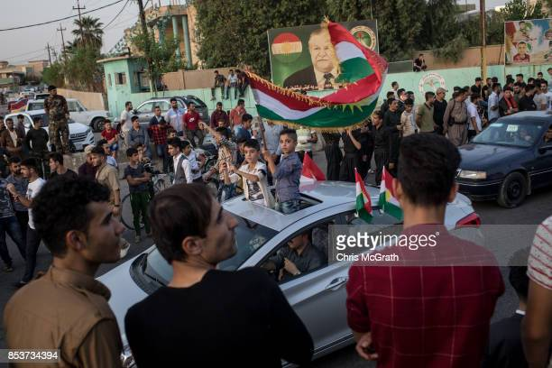 People celebrate on the streets after voting on September 25 2017 in Kirkuk Iraq Despite strong objection from neighboring countries and the Iraqi...