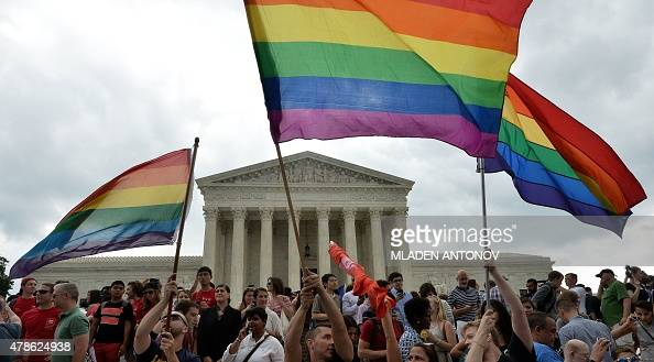 People celebrate outside the Supreme Court in Washington DC on June 26 2015 after its historic decision on gay marriage The US Supreme Court ruled...