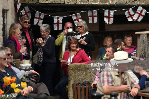 People celebrate St George's Day and the official start of the asparagus season at the The Fleece Inn in Bretforton Worcestershire