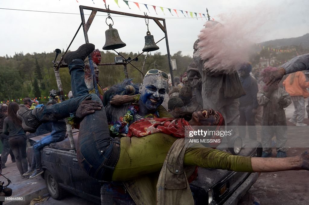 People celebrate the annual custom of Flour War in Galaxidi, some 250kms south east of Athens on March 18, 2013.