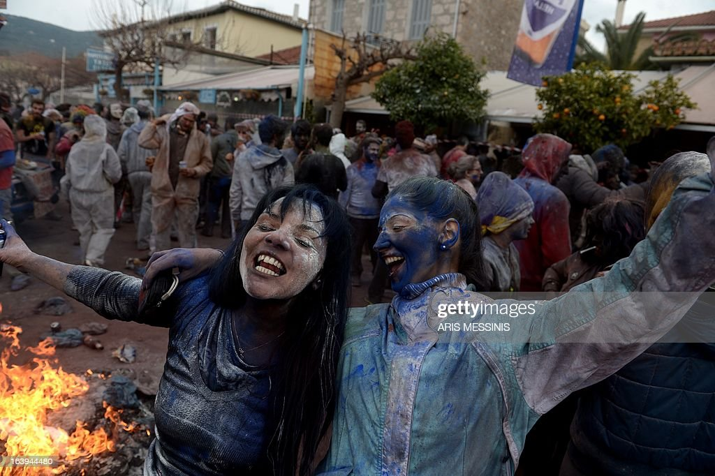 People celebrate the annual custom of Flour War in Galaxidi, some 250kms south east of Athens on March 18, 2013. AFP PHOTO / ARIS MESSINIS