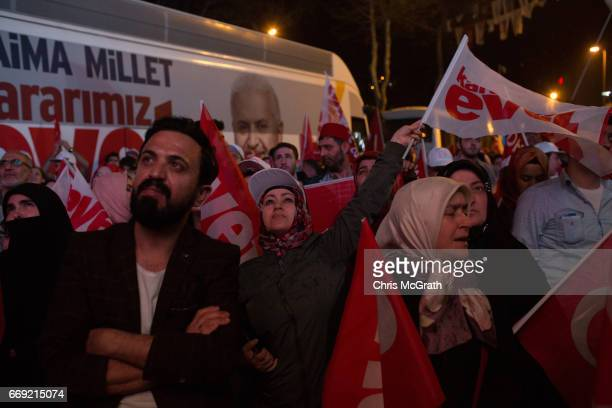 People celebrate the 'Evet' vote result outside AK Party headquarters on April 16 2017 in Istanbul Turkey According to unofficial results 5121% were...