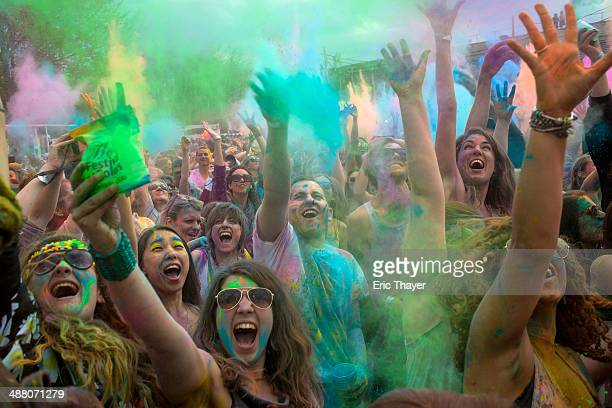 People celebrate the Indian Holi Festival May 3 2014 in the Brooklyn borough of New York City The Hindu festival of Holi also known as the Festival...