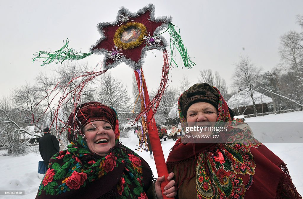 People celebrate the Malanka festival in the village of Pirogovo, near Kiev, on January 13, 2013. The local population traditionally celebrate Malanka on January 13th, which is New Year's Eve in accordance with the Julian calendar. AFP PHOTO/GENYA SAVILOV