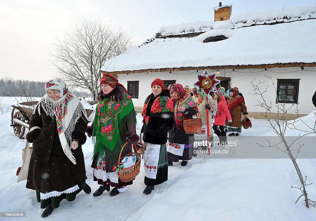 People celebrate the Malanka festival in the village of Pirogovo, near Kiev, on January 13, 2013. The local population traditionally celebrate Malanka on January 13th, which is New Year's Eve in accordance with the Julian calendar.