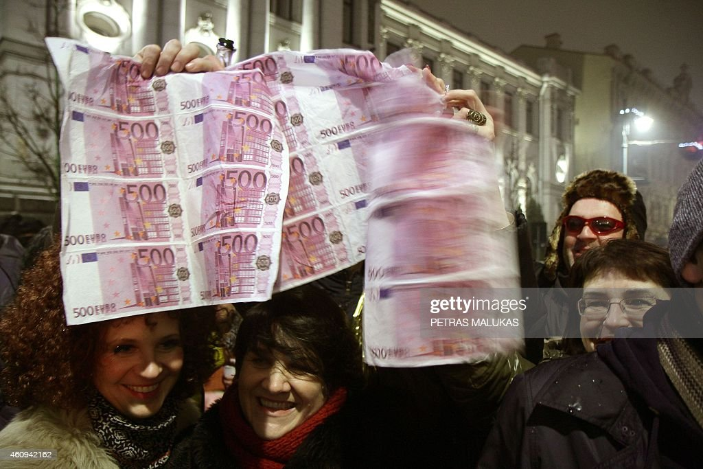 People celebrate the New Year in Vilnius on January 1 2015 Lithuania switched over to the euro on January 1st becoming the last Baltic nation to...