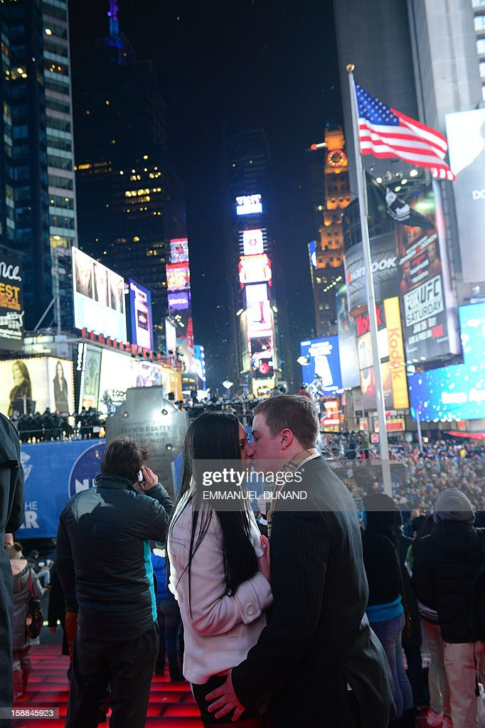 People celebrate the New Year on Times Square in New York, January 1, 2013. A million people cheered in New York's Times Square as the traditional crystal ball dropped to mark the start of 2013, bringing a rolling global New Year's party that kicked off in Australia to US shores.