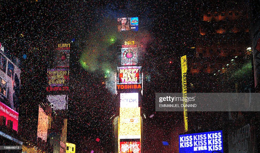 People celebrate the New Year on Times Square on January 1, 2013 in New York. A million people cheered in New York's Times Square as the traditional crystal ball dropped to mark the start of 2013, bringing a rolling global New Year's party that kicked off in Australia to US shores. AFP PHOTO/EMMANUEL DUNAND