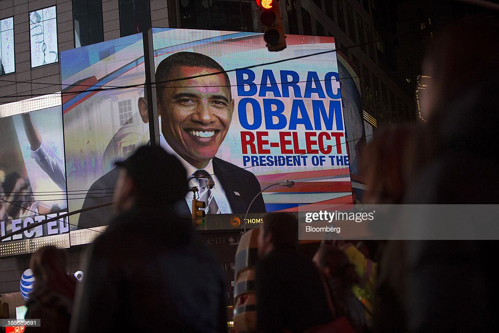 People celebrate the news that U.S. President <a gi-track='captionPersonalityLinkClicked' href=/galleries/search?phrase=Barack+Obama&family=editorial&specificpeople=203260 ng-click='$event.stopPropagation()'>Barack Obama</a> has won re-election at Times Square in New York, U.S., on Wednesday, Nov. 7, 2012. <a gi-track='captionPersonalityLinkClicked' href=/galleries/search?phrase=Barack+Obama&family=editorial&specificpeople=203260 ng-click='$event.stopPropagation()'>Barack Obama</a>, the post-partisan candidate of hope who became the first black U.S. president, won re-election today by overcoming four years of economic discontent with a mix of political populism and electoral math. Photographer: Scott Eells/Bloomberg via Getty Images