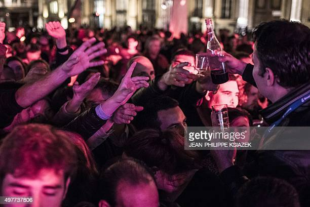 People celebrate the official launch of the Beaujolais Nouveau wine on November 19 2015 in the center Lyon eastern France during the 2015 vintage...