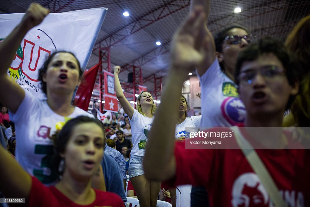 People celebrate the speech of the Former President of Brazil, Luiz Inacio Lula da Silva, at a rally at the Partido dos Trabalhadores headquarters on March 4, 2016, in Sao Paulo, Brazil. Lula is accused of corruption and embezzlement in the Federal Police investigation involving fraud at Petrobras company.