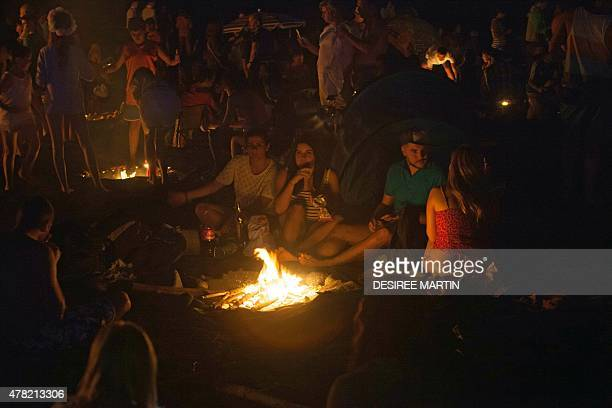 People celebrate the traditional Saint John night which coincides with the summer solstice with bonfires at the beach of Puerto de La Cruz on the...