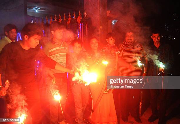 People celebrates Diwali festival on October 23 2014 in Ghaziabad India Diwali the festival of lights was celebrated with traditional fervour across...