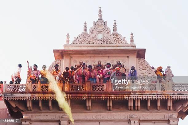 People celebrating Holi festival in a temple Barsana Uttar Pradesh India