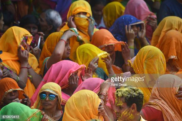 People celebrating Holi festival in Baldeo town, near Mathura, India.