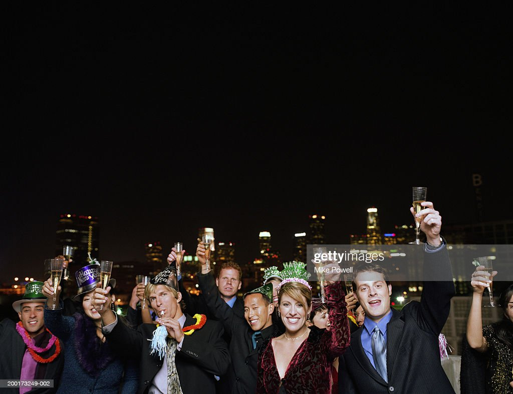 People celebrating on rooftop at New Years Eve party, portrait : Stock Photo