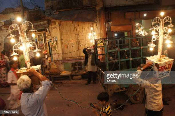 People celebrating on the streets of Pushkar carrying light garlands