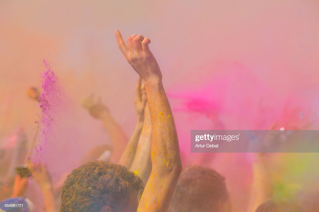 People celebrating the Barcelona Holi with colors