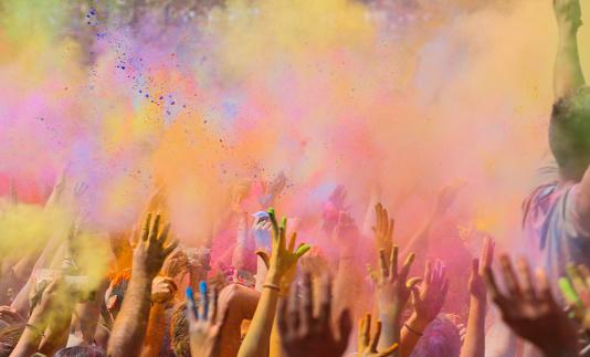 People celebrating the holi festival in Barcelona.