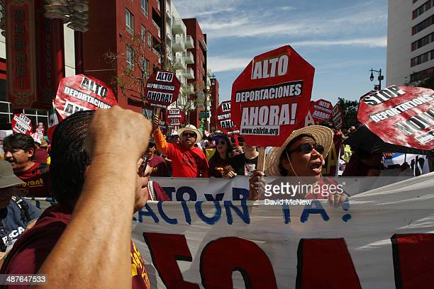 People chant before marching to the Metropolitan Detention Center during one a several May Day immigrationthemed events on May 1 2014 in Los Angeles...