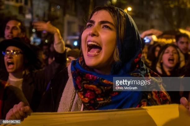 People chant slogans and march in the street protesting the result of last nights constitutional referendum on April 17 2017 in Istanbul Turkey...