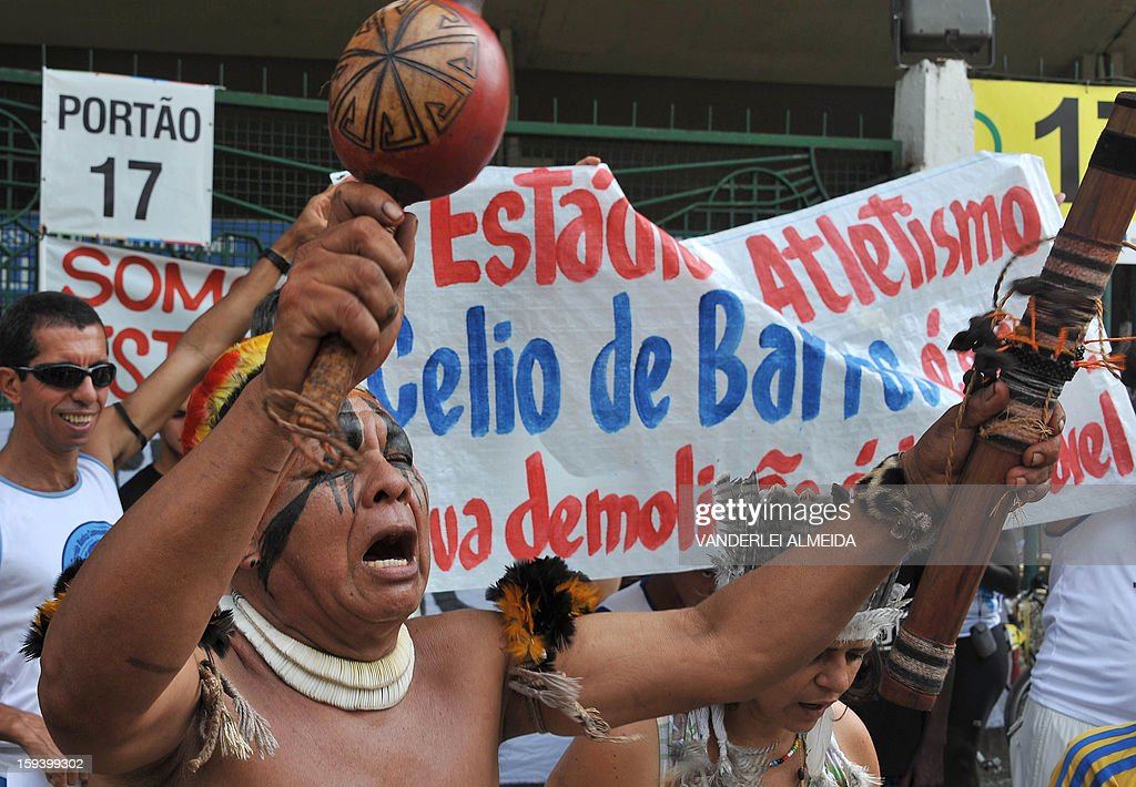 People chant slogans during a protest against the demolition of the Celio de Barros track and field stadium in Rio de Janeiro, Brazil on January 13, 2013. The stadium needs to be demolished to carry out the Maracana stadium construction plans ahead of the 2013 FIFA Confederations Cup, 2014 FIFA World Cup and 2016 Olympic games.