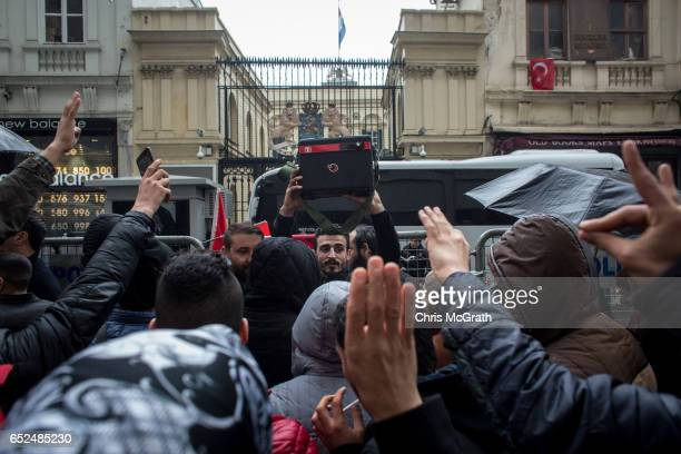 People chant slogans in front of the Dutch Consulate on March 12 2017 in Istanbul Turkey Security has been increased around the Dutch consulate after...