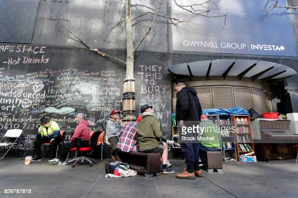 People chat at the Martin Place homeless camp on August 6 2017 in Sydney Australia About 50 homeless residents face eviction after the state...