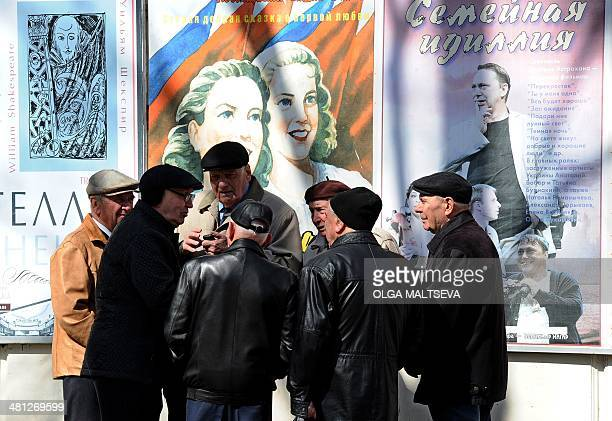 People chat on a street in Sevastopol on March 29 2014 Ethnic Tatars from all over Crimea convened in the town of Bakhchisaray for an emergency...