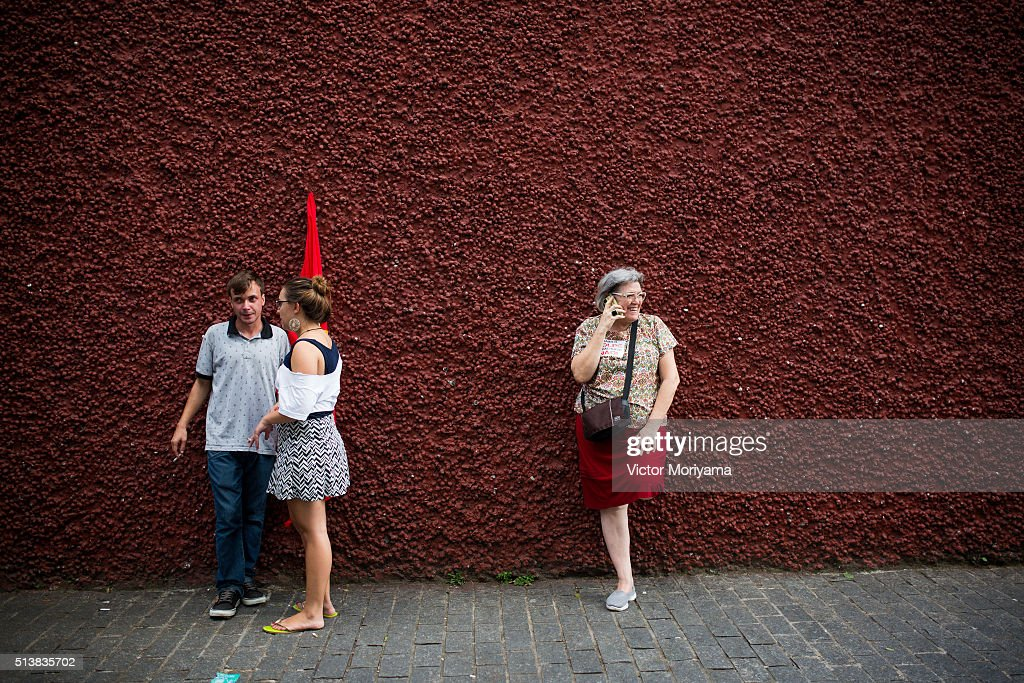 People chat outside a rally for the Former President of Brazil, Luiz Inacio Lula da Silva at the Partido dos Trabalhadores headquarters on March 4, 2016, in Sao Paulo, Brazil. Lula is accused of corruption and embezzlement in the Federal Police investigation involving fraud at Petrobras company.