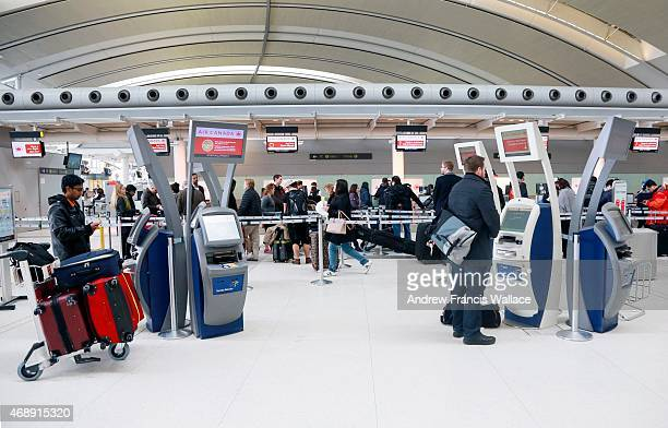 People check in with their Air Canada flights at Pearson airport February 2 2015 Snow with high winds and cold temperatures hits the GTA caused a...