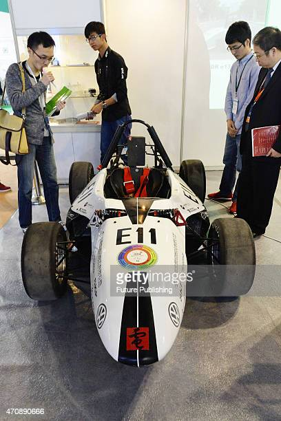 People check out a 3D printed car exhibited at China International Technology Fair on April 23 2015 in Shanghai China About 30% of the overall parts...