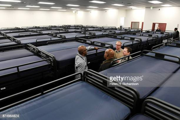 DENVER CO NOVEMBER 15 People check out the 200 new beds available at the new homeless shelter for men called the Holly Center on November 15 2017 in...