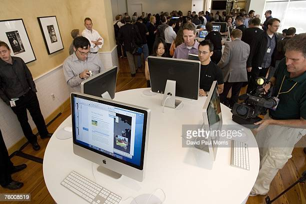 People check out the new iMac after Apple CEO Steve Jobs introduces new versions of the iMac and iLife applications August 7 2007 in Cupertino...