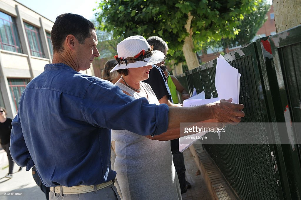 People check that their names are on the voting register for the Spanish general election on June 26, 2016 in Madrid, Spain. Spanish voters head back to the polls on June 26 after the last election in December failed to produce a government. Latest opinion polls suggest the Unidos Podemos left-wing alliance could make enough gains to come in second behind the caretaker government of the center-right Popular Party.