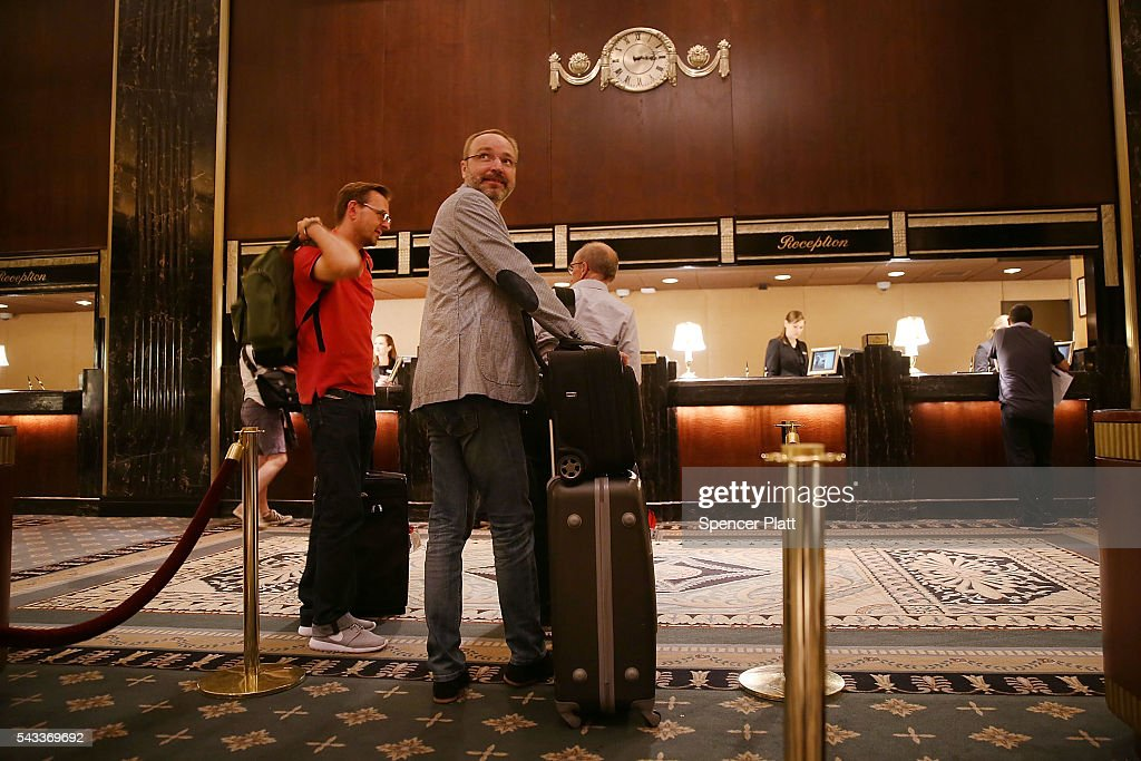 People check-in to New York's landmark Waldorf Astoria Hotel on June 27, 2016 in New York City. China's Anbang Insurance Group, which recently purchased the Waldorf from Hilton Worldwide Holdings in 2014 for $1.95 billion, has announced plans to convert as much as three-quarters of the rooms into apartments. The insurer will close the Waldorf for up to three years starting next spring for the renovation.