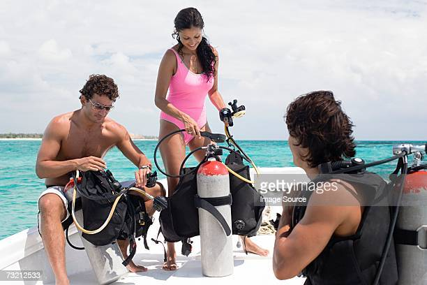 People checking diving equipment