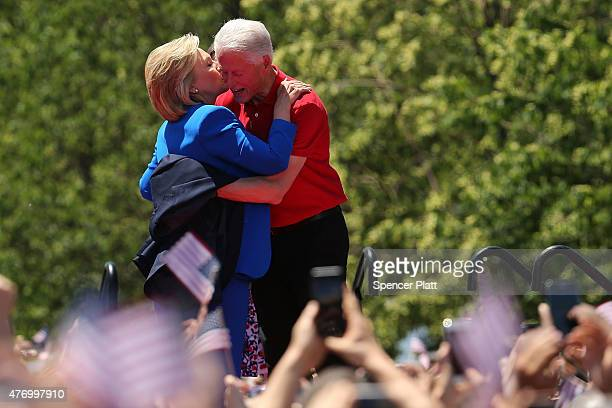 People cheer after Democratic Presidential candidate Hillary Clinton stands on stage with her husband former president Bill Clinton after her...