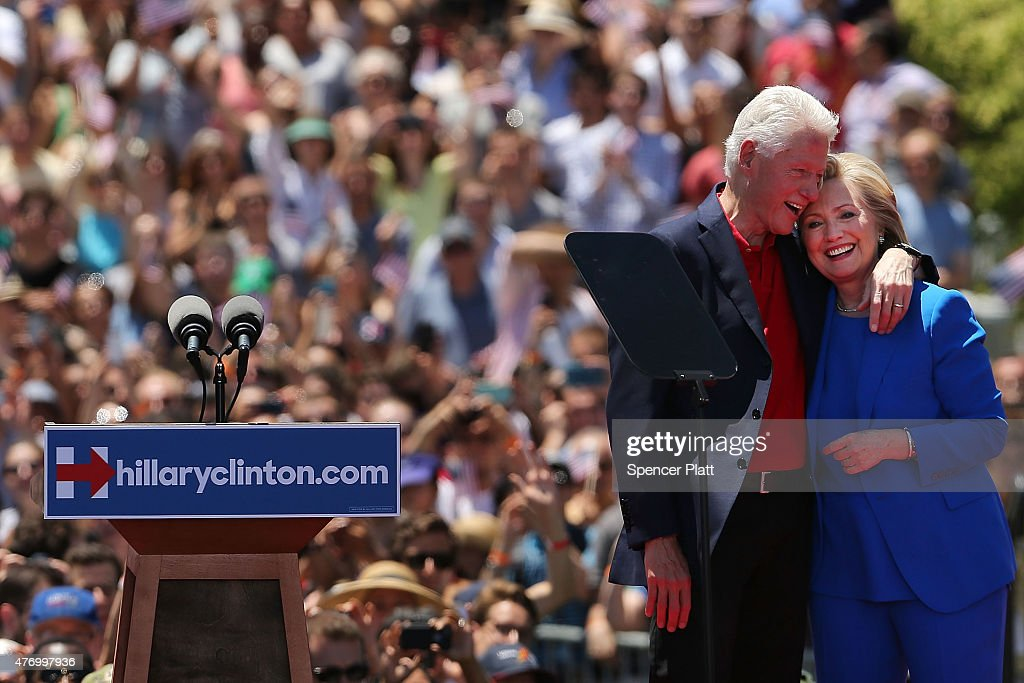 People cheer after Democratic Presidential candidate Hillary Clinton stands on stage with her husband former president Bill Clinton after her official kickoff rally at the Four Freedoms Park on Roosevelt Island in Manhattan on June 13, 2015 in New York City. The long awaited speech at a historical location associated with the values Franklin D. Roosevelt outlined in his 1941 State of the Union address, is the Democratic the candidateÕs attempt to define the issues of her campaign to become the first female president of the United States.