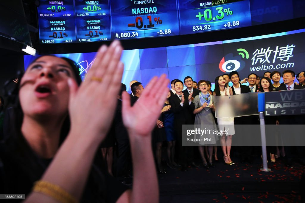 People cheer as China's Weibo began trading on the Nasdaq exchange under the ticker symbol WB on April 17, 2014 in New York City. Weibo Corp, a Twitter-like messaging service company, priced its initial public offering (IPO) at $17 per American Depository Share (ADS).