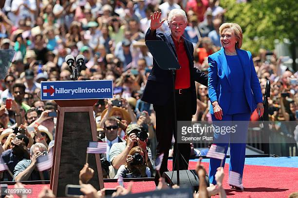 People cheer as Democratic Presidential candidate Hillary Clinton stands on stage with her husband former president Bill Clinton after her official...