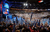 People cheer as First lady Michelle Obama speaks on stage during day one of the Democratic National Convention at Time Warner Cable Arena on...